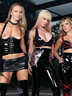 Three gorgeous blonds got themselves into tight glossy rubber and ready to take some femdom activities