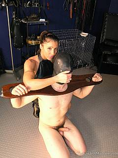 Cruel mistress is in her chamber and training yet another miserable slave by using a selection of BDSM equipment and racks