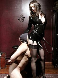 Femdom humiliation starts with hot girl spitting into slave's mouth and makes him suck the strap-n rubber dick she is wearing
