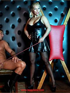 Dominatrix is making cock hard with cane strokes and then plugs in straight into her wet pussy