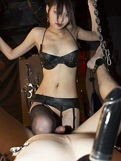 Skinny asian slut is suing chains to bind big and strong man while she is teasing and tormenting him