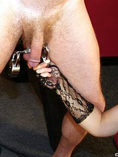 The best settings for cruel girl to torture balls and penis is when male slave exposed on BDSM cross