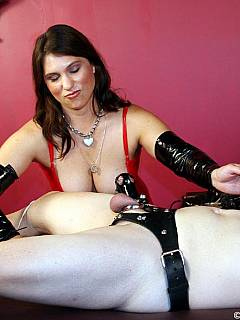 Busty babe is rolling spike wheel along the cock making it shrink from extreme pain