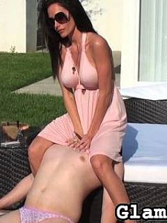 Busty Goddess comes out to the poolside in sexy pink dress to smother a man with her bum and pussy