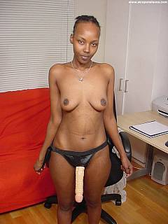 Black babe comes to the office to pleasure white sissies with the big rubber strap-on