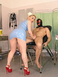 Dude is exposed in medical chair for the period of time sexy nurse in latex performing kinky operations with this cock collecting the cum