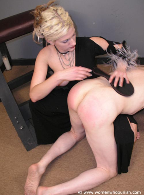 Picture #7 of Dominatrix in posh dress is spanking kneeling an so hard that one of her boobs jumps out of the clothing