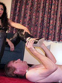 Fetish Goddess is all dressed up in black lather and wearing spike heels to make trampling more painful for the slave