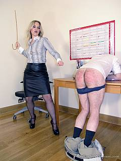 Submissive boss is experiencing the most exciting moments of the working day when sexy secretary pulls down his pants, paddles and spanks his ass