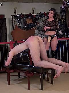 Cruel woman is keeping big strap-on non lubricated when slowly penetrating a man in his ass