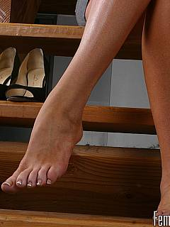 Goddess is sitting on the stairs in high heels and mini dress: you may take down her shoes and suck the tasty toes