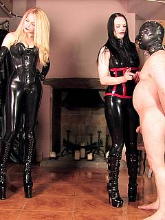 Smoking ladies are enjoying themselves in the BDSM chamber where they torture two male slaves and making them cum onto each other