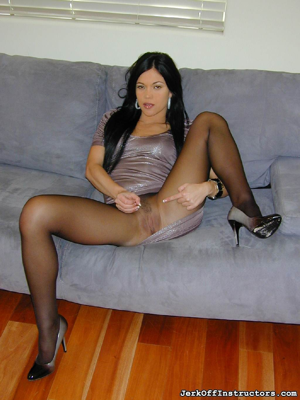 Picture #2 of Goddess is pantyhose would better deal with rubber cock than with your tiny penis: watch her inserting the toy into the hole in the nylon