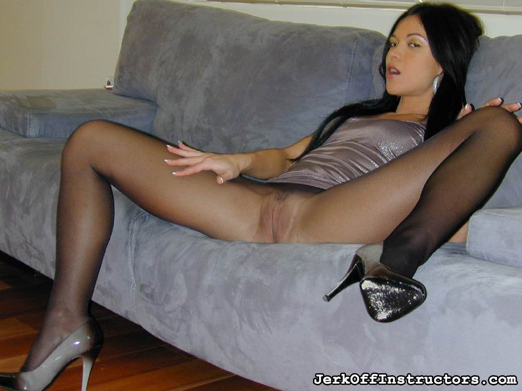 Picture #3 of Goddess is pantyhose would better deal with rubber cock than with your tiny penis: watch her inserting the toy into the hole in the nylon