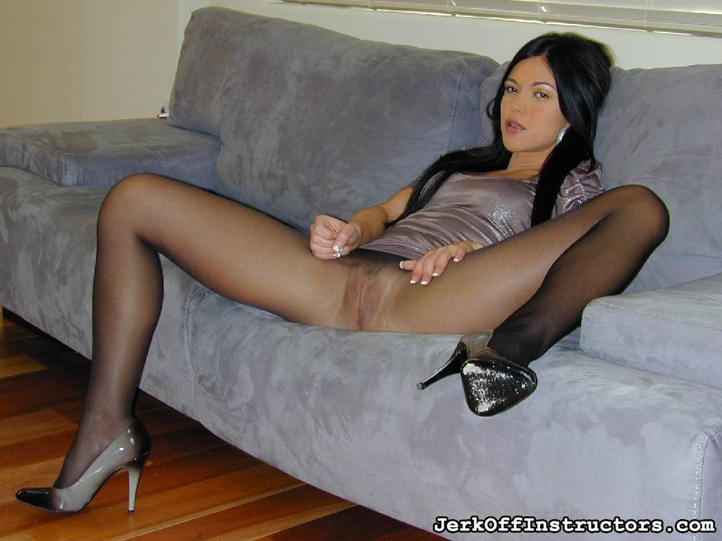 Picture #4 of Goddess is pantyhose would better deal with rubber cock than with your tiny penis: watch her inserting the toy into the hole in the nylon