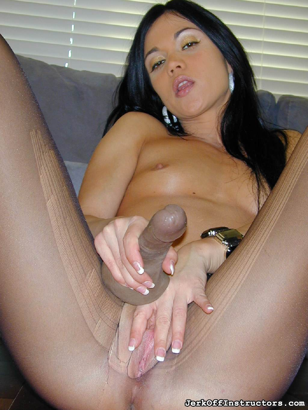 Picture #6 of Goddess is pantyhose would better deal with rubber cock than with your tiny penis: watch her inserting the toy into the hole in the nylon