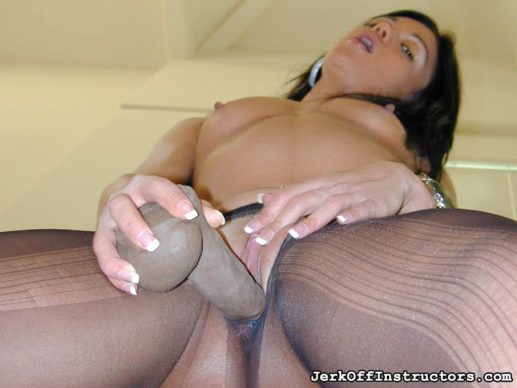 Picture #11 of Goddess is pantyhose would better deal with rubber cock than with your tiny penis: watch her inserting the toy into the hole in the nylon