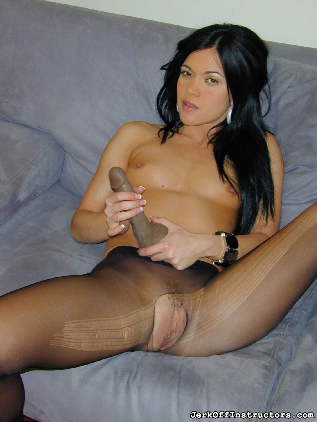 Picture #13 of Goddess is pantyhose would better deal with rubber cock than with your tiny penis: watch her inserting the toy into the hole in the nylon