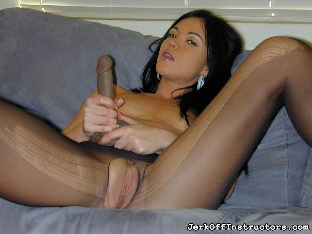 Picture #14 of Goddess is pantyhose would better deal with rubber cock than with your tiny penis: watch her inserting the toy into the hole in the nylon