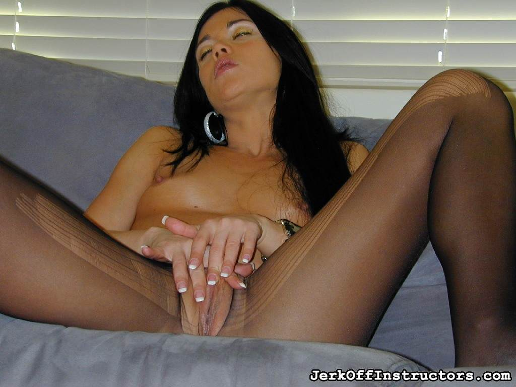 Picture #15 of Goddess is pantyhose would better deal with rubber cock than with your tiny penis: watch her inserting the toy into the hole in the nylon