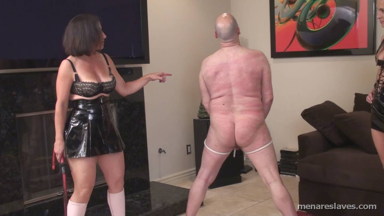 Picture #6 of MILF wife is dressed up in kinky PVC and taking lesson from the professional dominatrix on how to dominate and punish her husband