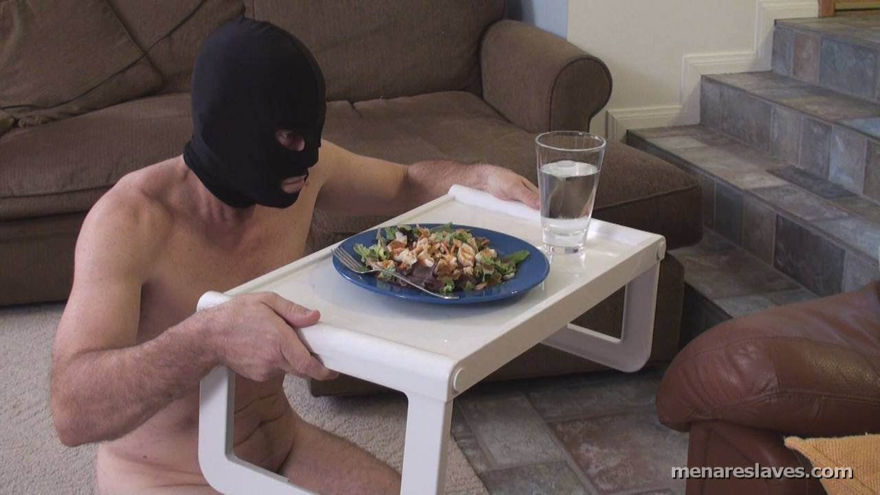 Picture #3 of Nicely-trained slave is delivering lunch to his mistress and kissing her bare feel while she is enjoying her meal
