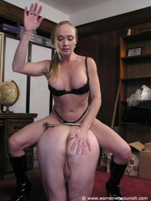 Picture #2 of It is very joyful for the lingerie bitch to sit on top of kneeling femdom slave and to paddle his as with full force