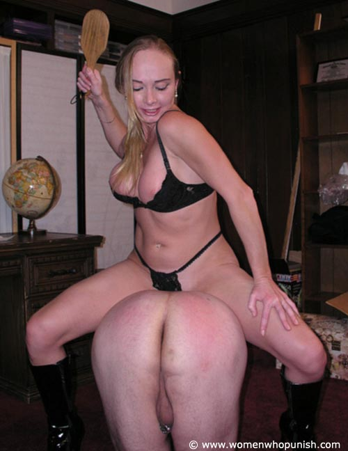Picture #6 of It is very joyful for the lingerie bitch to sit on top of kneeling femdom slave and to paddle his as with full force