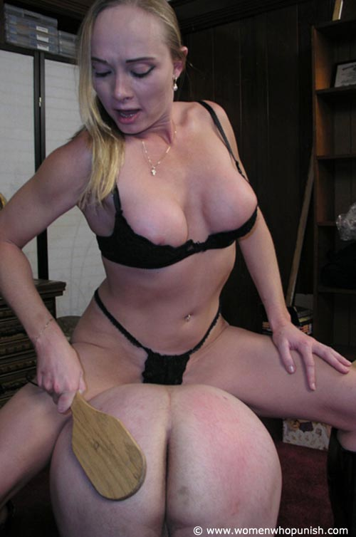 Picture #7 of It is very joyful for the lingerie bitch to sit on top of kneeling femdom slave and to paddle his as with full force