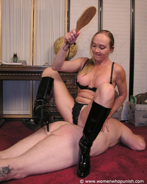 Picture #11 of It is very joyful for the lingerie bitch to sit on top of kneeling femdom slave and to paddle his as with full force