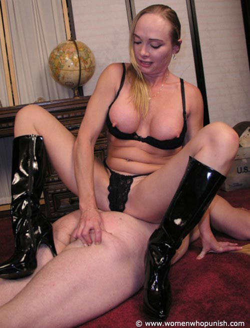 Picture #13 of It is very joyful for the lingerie bitch to sit on top of kneeling femdom slave and to paddle his as with full force