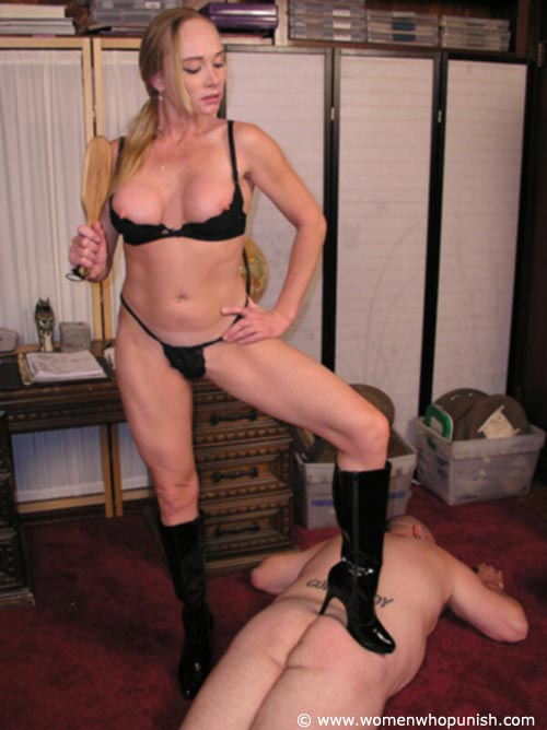 Picture #14 of It is very joyful for the lingerie bitch to sit on top of kneeling femdom slave and to paddle his as with full force