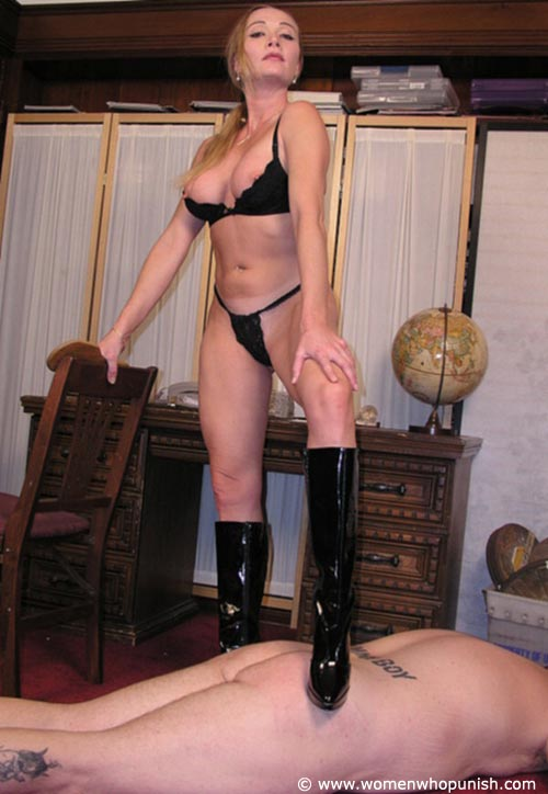 Picture #15 of It is very joyful for the lingerie bitch to sit on top of kneeling femdom slave and to paddle his as with full force