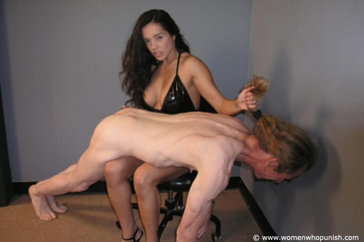 Picture #3 of Latin Goddess is warming up femdom slave with ass spanking while pulling his hair