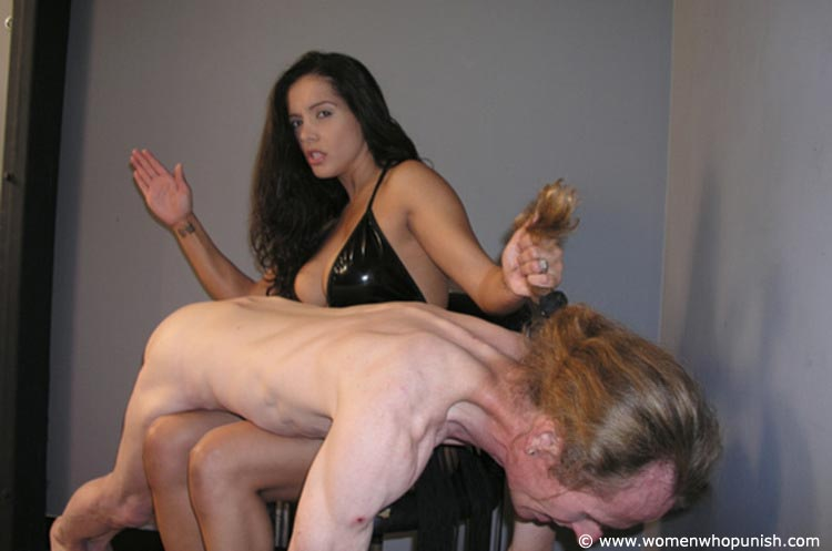 Picture #4 of Latin Goddess is warming up femdom slave with ass spanking while pulling his hair