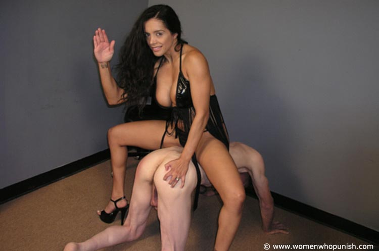 Picture #6 of Latin Goddess is warming up femdom slave with ass spanking while pulling his hair
