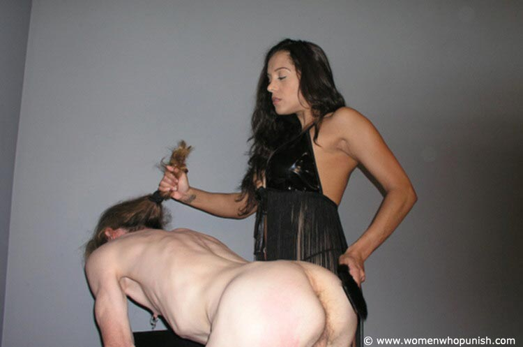Picture #12 of Latin Goddess is warming up femdom slave with ass spanking while pulling his hair