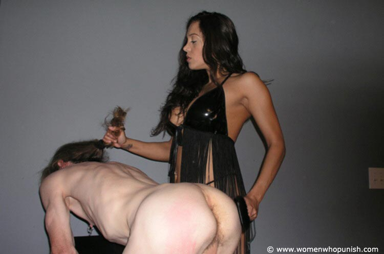 Picture #13 of Latin Goddess is warming up femdom slave with ass spanking while pulling his hair