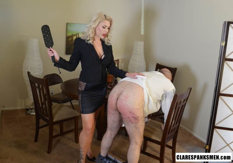 Picture #4 of Bald man is enjoying the humiliation provided by blond goddess by pulling his pants and paddling him hard