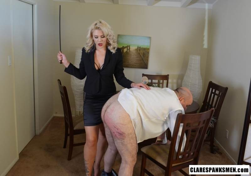 Picture #8 of Bald man is enjoying the humiliation provided by blond goddess by pulling his pants and paddling him hard