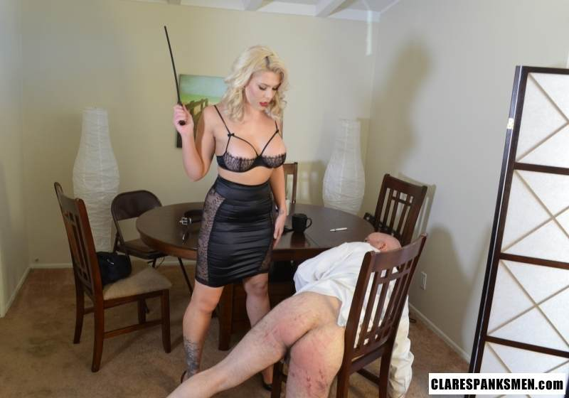 Picture #15 of Bald man is enjoying the humiliation provided by blond goddess by pulling his pants and paddling him hard
