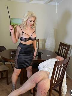 Bald man is enjoying the humiliation provided by blond goddess by pulling his pants and paddling him hard