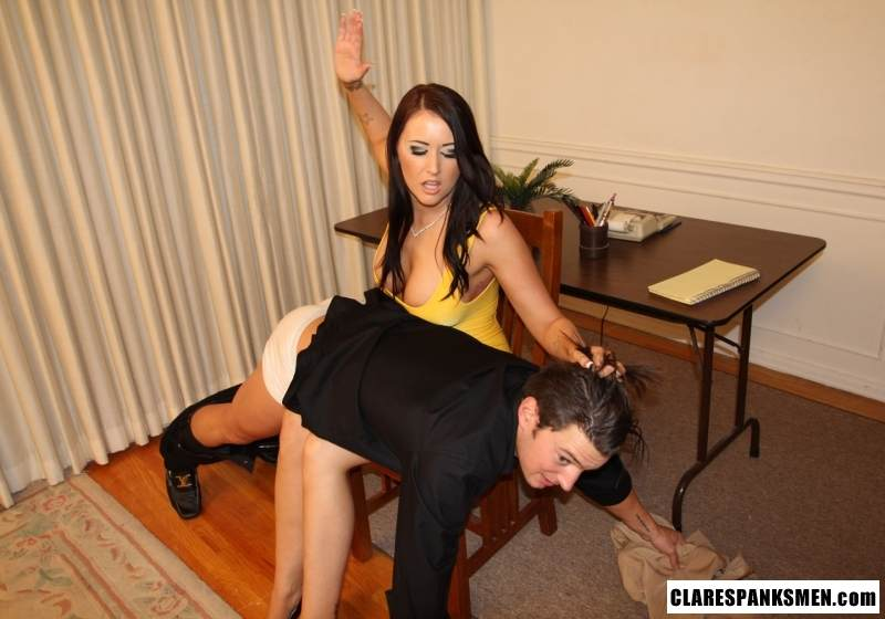 Picture #5 of Busty babe with sexy cleavage is using paddle on the man over her knees and then spanks him hard