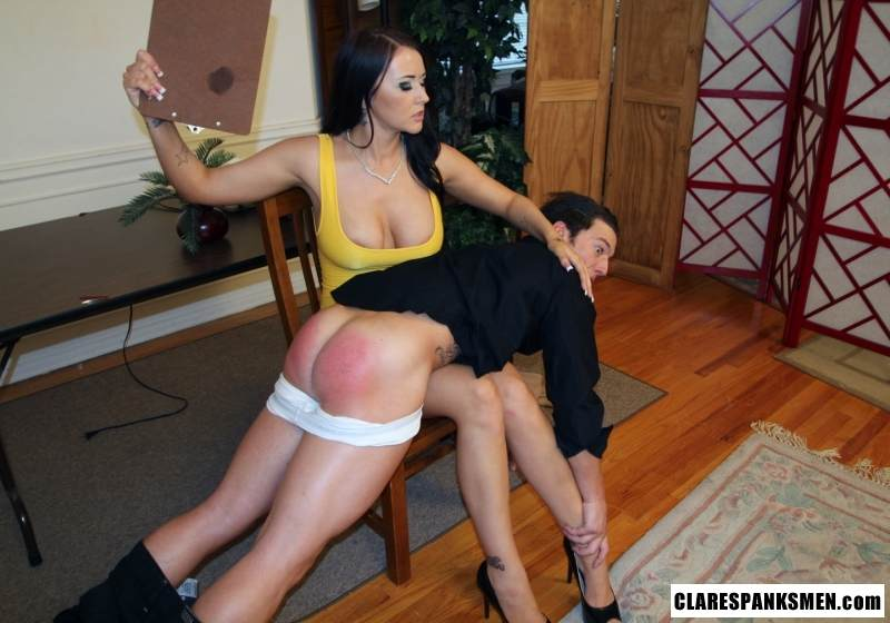 Picture #11 of Busty babe with sexy cleavage is using paddle on the man over her knees and then spanks him hard