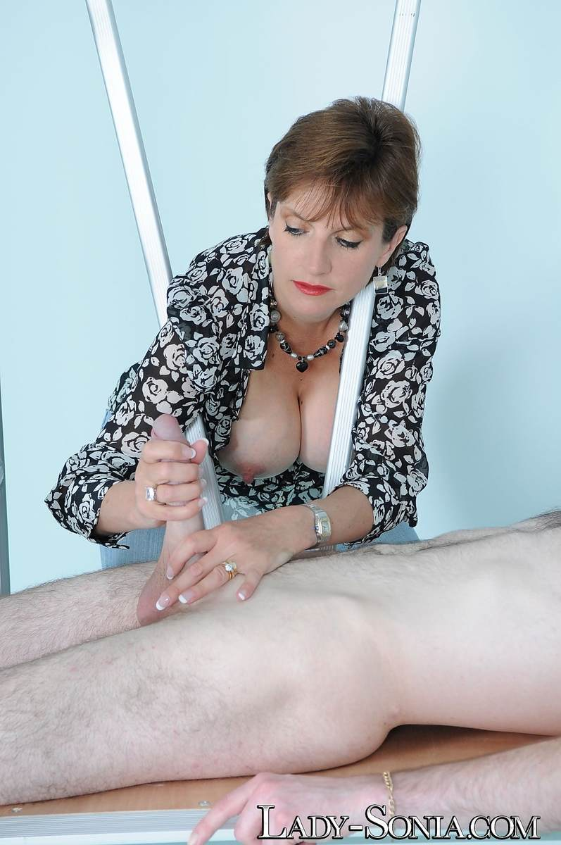 Picture #15 of Tall dominatrix in blue jeans is playing with big cock: teasing it and stroking but no orgasms are going to be allowed