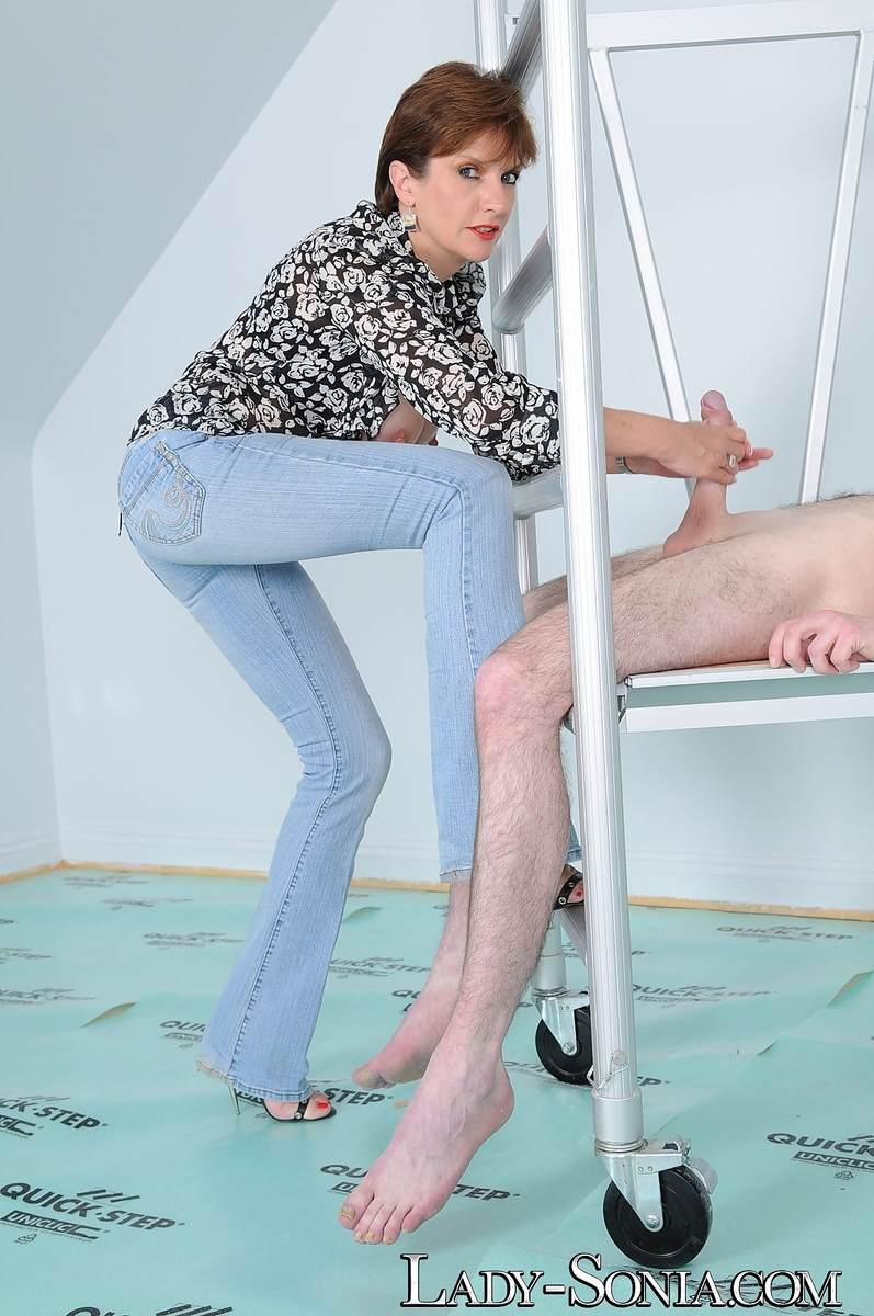 Picture #16 of Tall dominatrix in blue jeans is playing with big cock: teasing it and stroking but no orgasms are going to be allowed