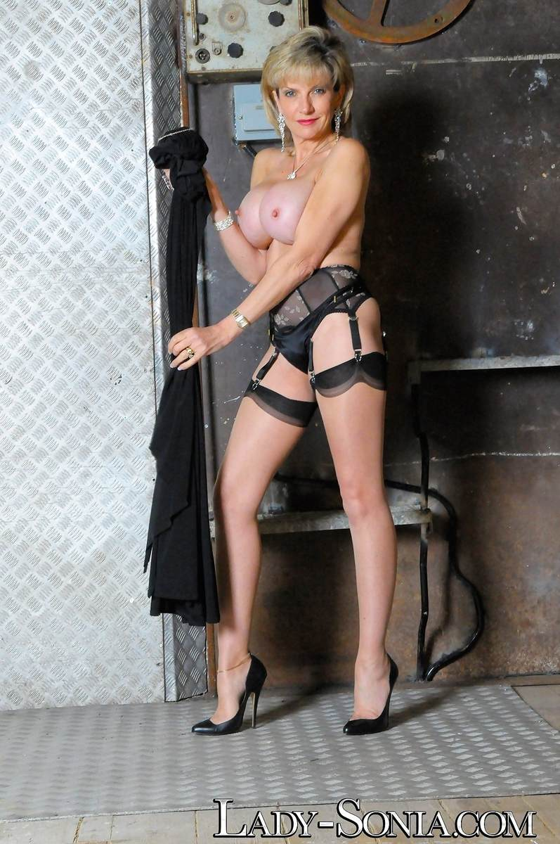Picture #3 of Stockings and garter belt is the only clothing busty dominatrix will be wearing when taking cage of you and your penis