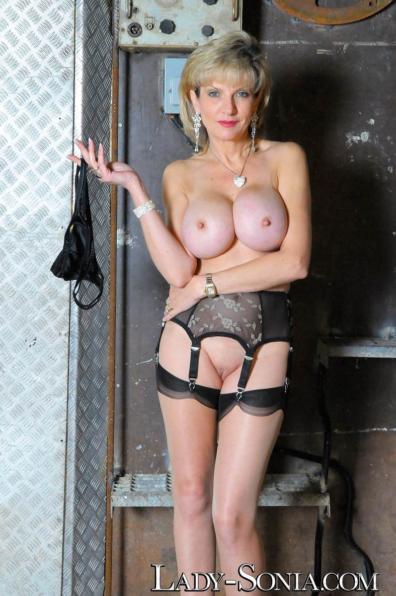 Picture #15 of Stockings and garter belt is the only clothing busty dominatrix will be wearing when taking cage of you and your penis