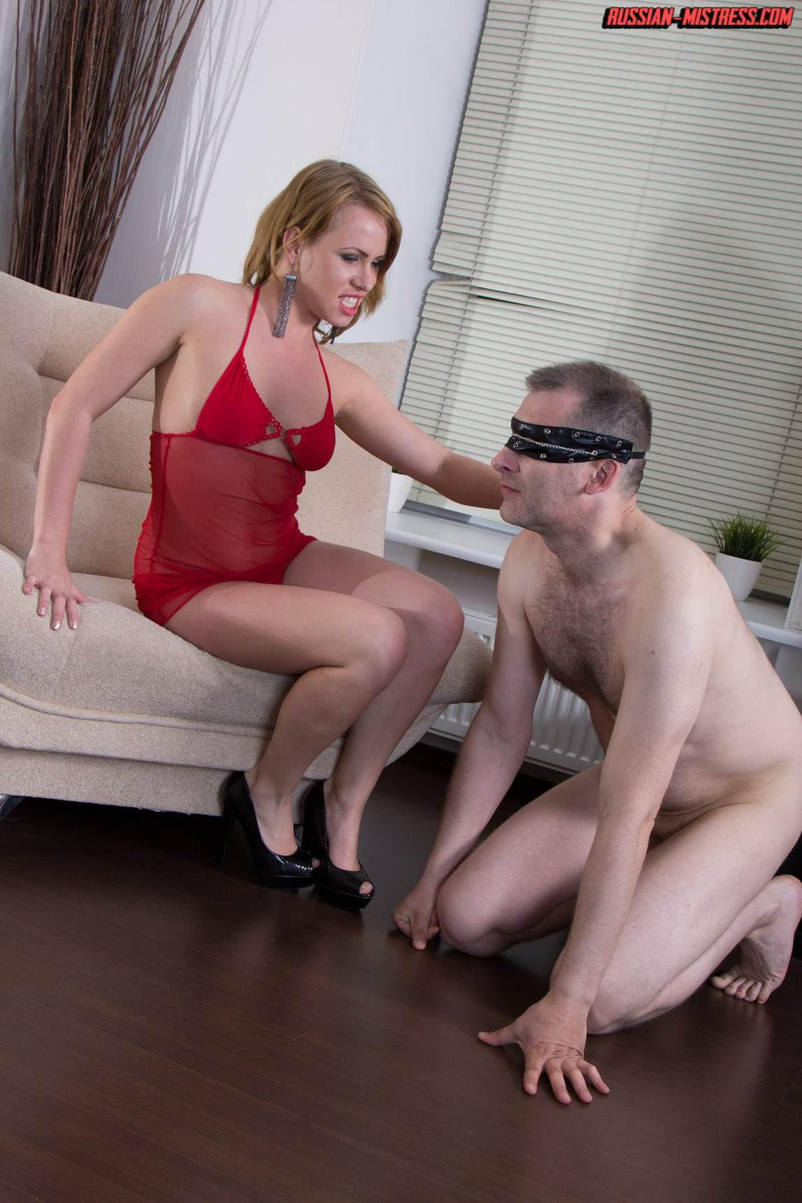 Picture #1 of Cruel bitch is loving wearing red lingerie and heels when pushing slave's face in between her butt cheeks and then peeing then over him