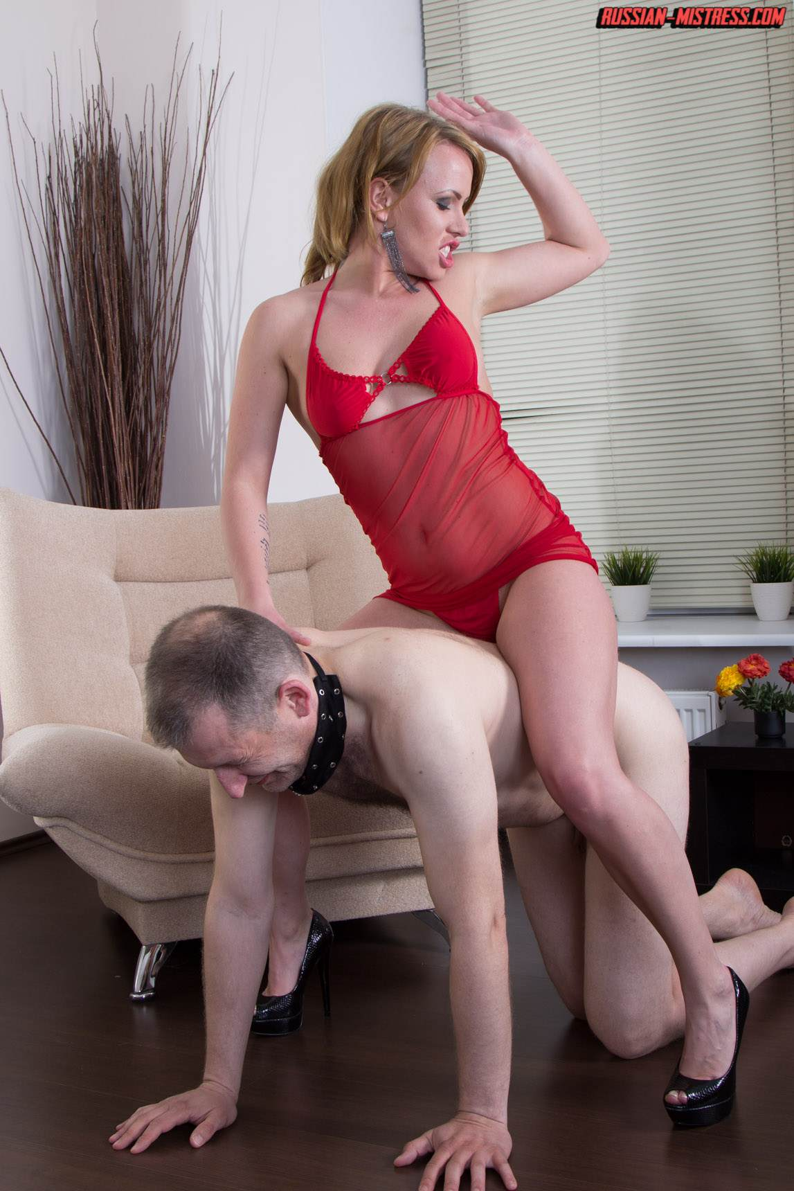 Picture #2 of Cruel bitch is loving wearing red lingerie and heels when pushing slave's face in between her butt cheeks and then peeing then over him
